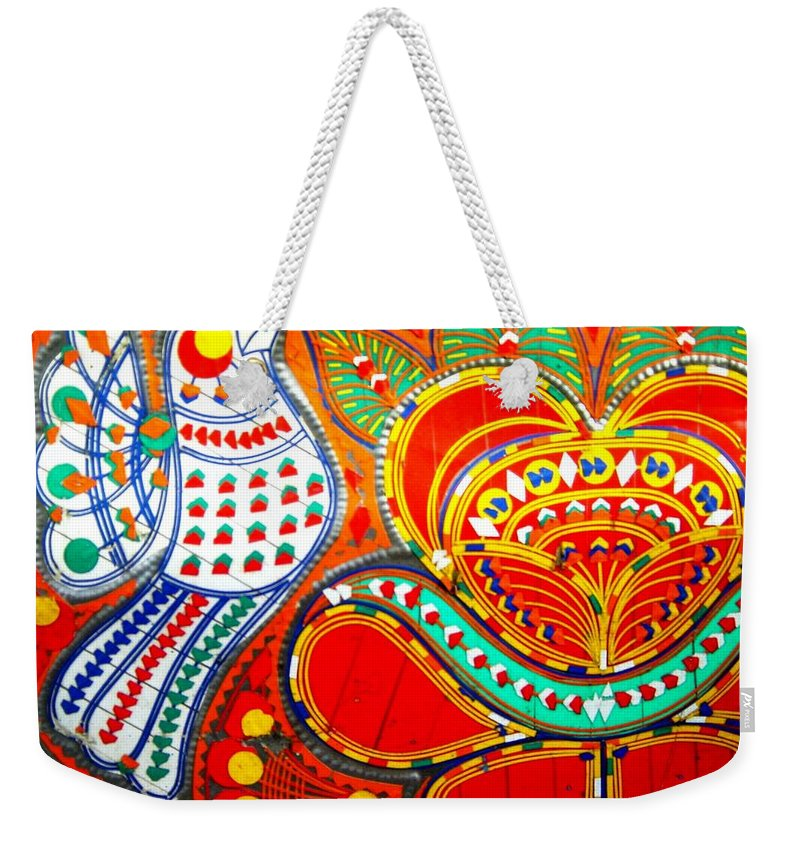 Fantasy Folk Art Weekender Tote Bag featuring the painting Jinga Bird by Fareeha Khawaja