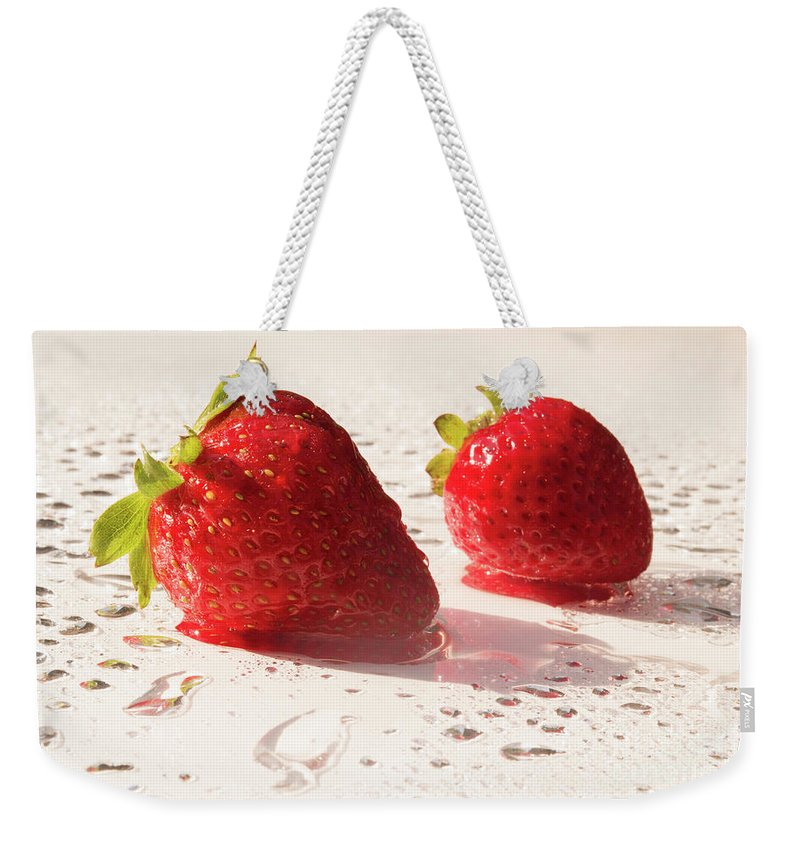 Juicy Weekender Tote Bag featuring the photograph Juicy Strawberries by Michelle Himes