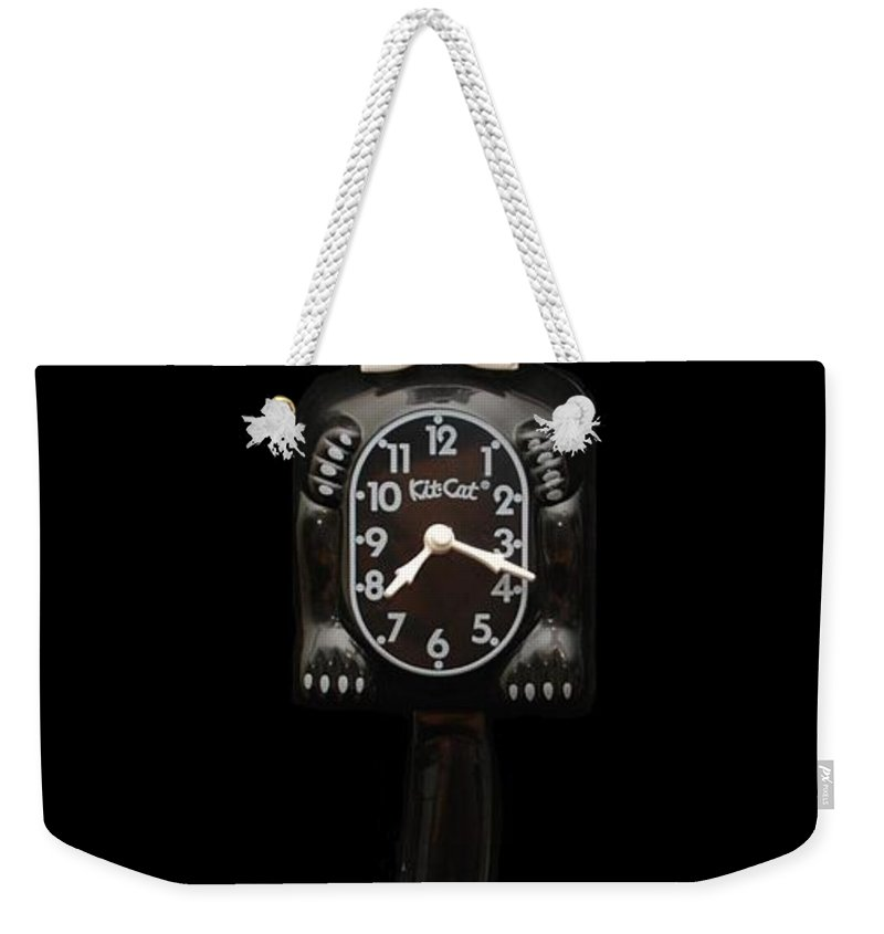 Black And White Weekender Tote Bag featuring the photograph Kit Cat Klock by Rob Hans