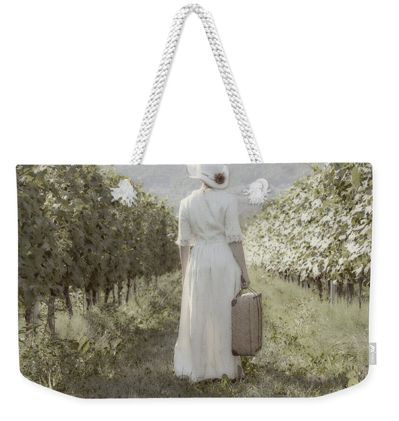 Female Weekender Tote Bag featuring the photograph Lady In Vineyard by Joana Kruse