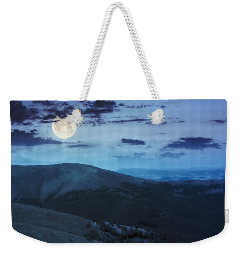 Landscape Weekender Tote Bag featuring the photograph Light On Stone Mountain Slope With Forest At Night by Michael Pelin