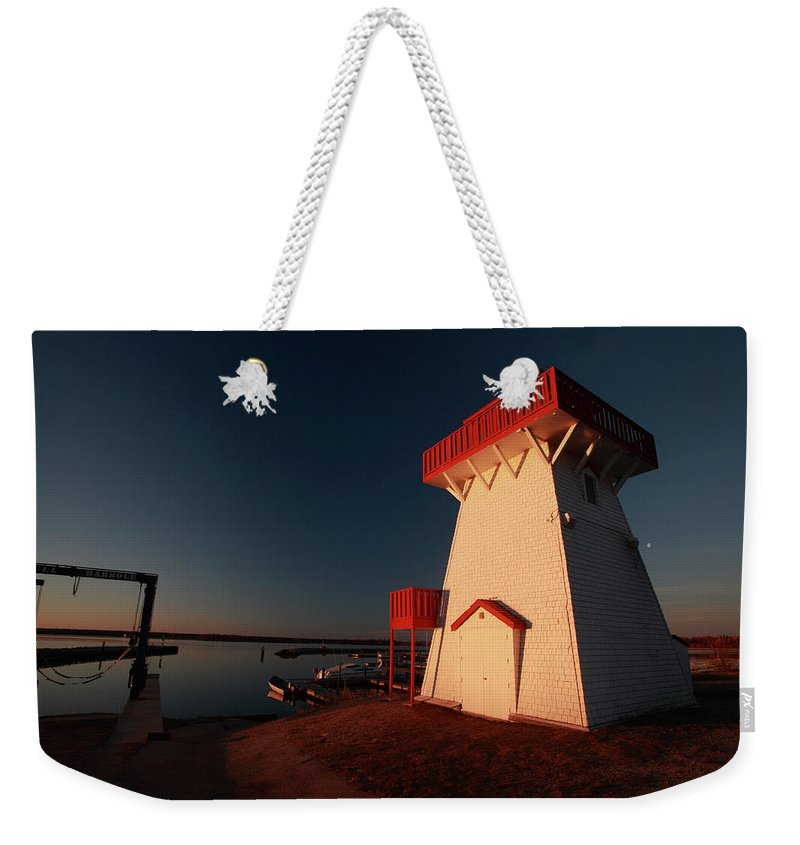 Lighthouse Weekender Tote Bag featuring the digital art Lighthouse And Marina At Hecla In Manitoba by Mark Duffy