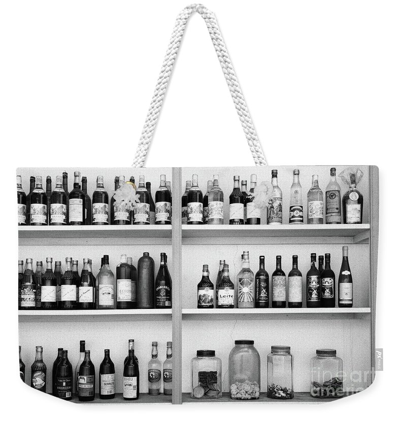 Bottles Weekender Tote Bag featuring the photograph Liquor Bottles by Gaspar Avila