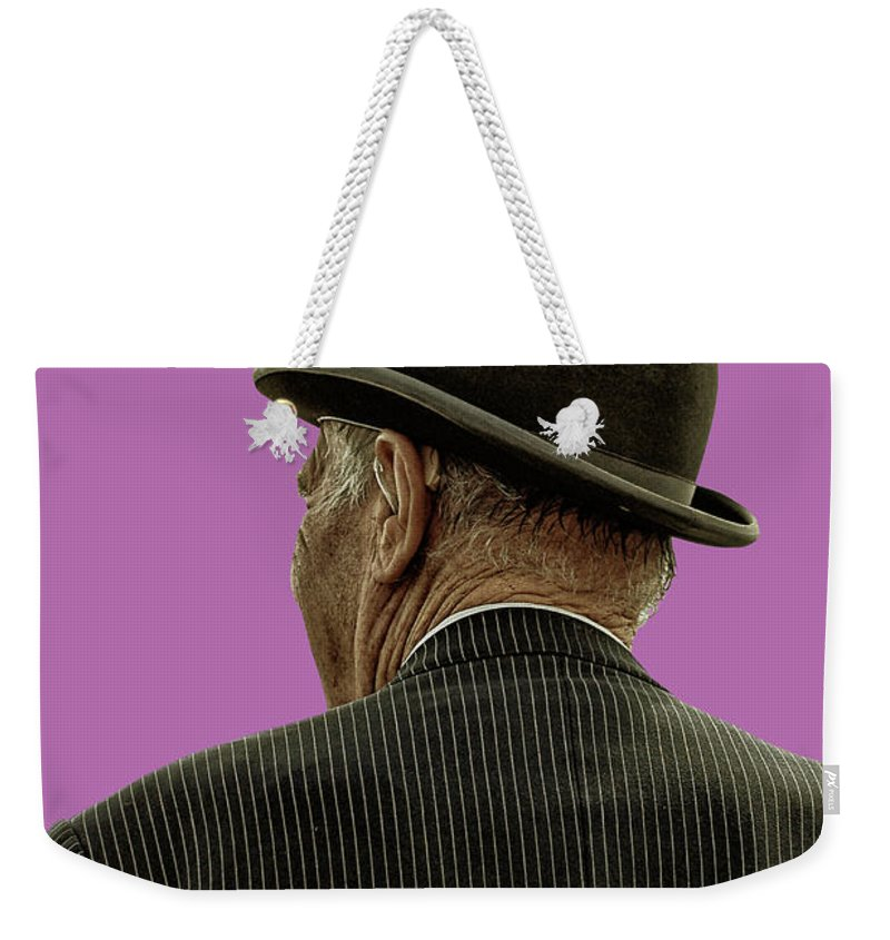 Bowler Hat Weekender Tote Bag featuring the photograph Man With A Bowler Hat by Toula Mavridou-Messer