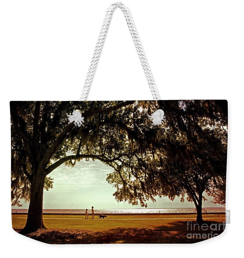 Mandeville Weekender Tote Bag featuring the photograph Mandeville Lakefront by Scott Pellegrin
