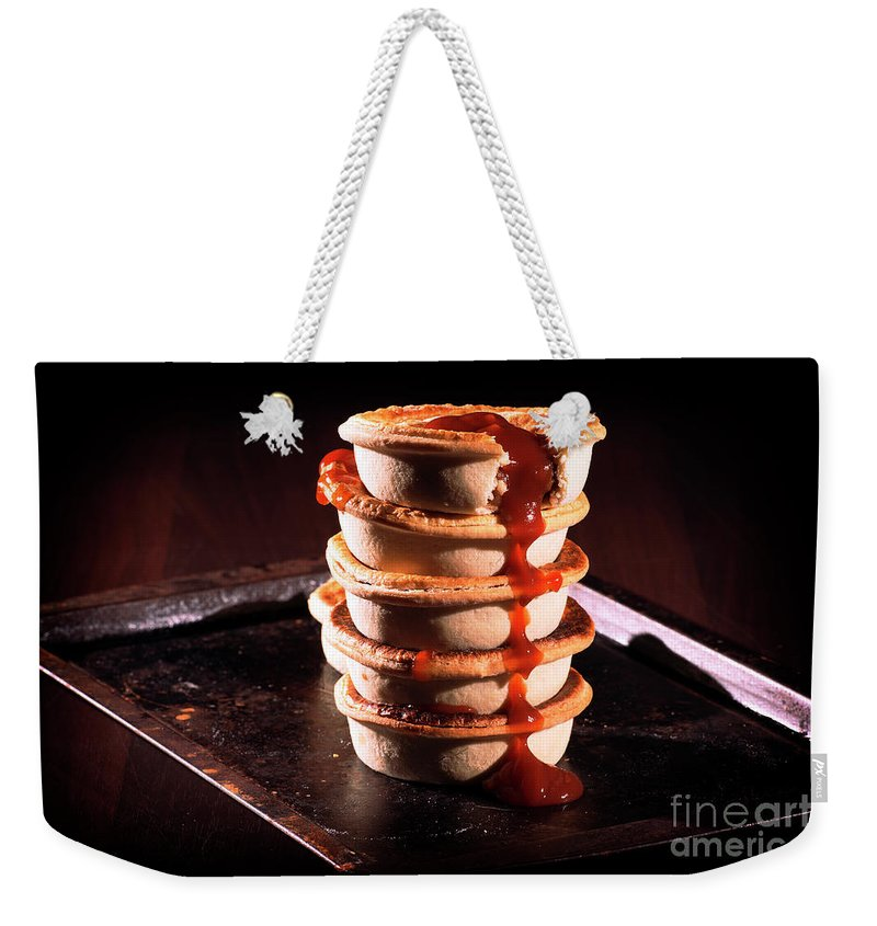 Aussie Weekender Tote Bag featuring the photograph Meat Pies With Sauce And High Contrast Lighting. by Rob D