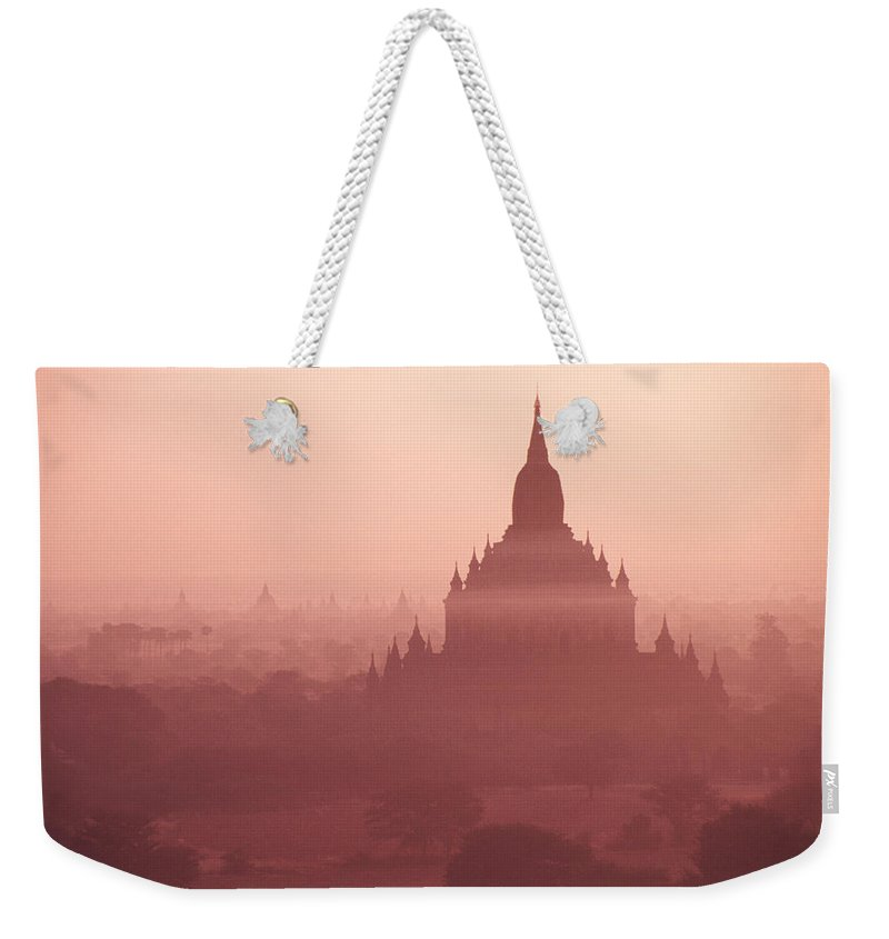 Mist Weekender Tote Bag featuring the photograph Misty Dawn In Bagan by Michele Burgess
