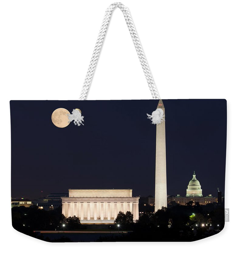 Moon Weekender Tote Bag featuring the photograph Moon Rising In Washington Dc by Steven Heap