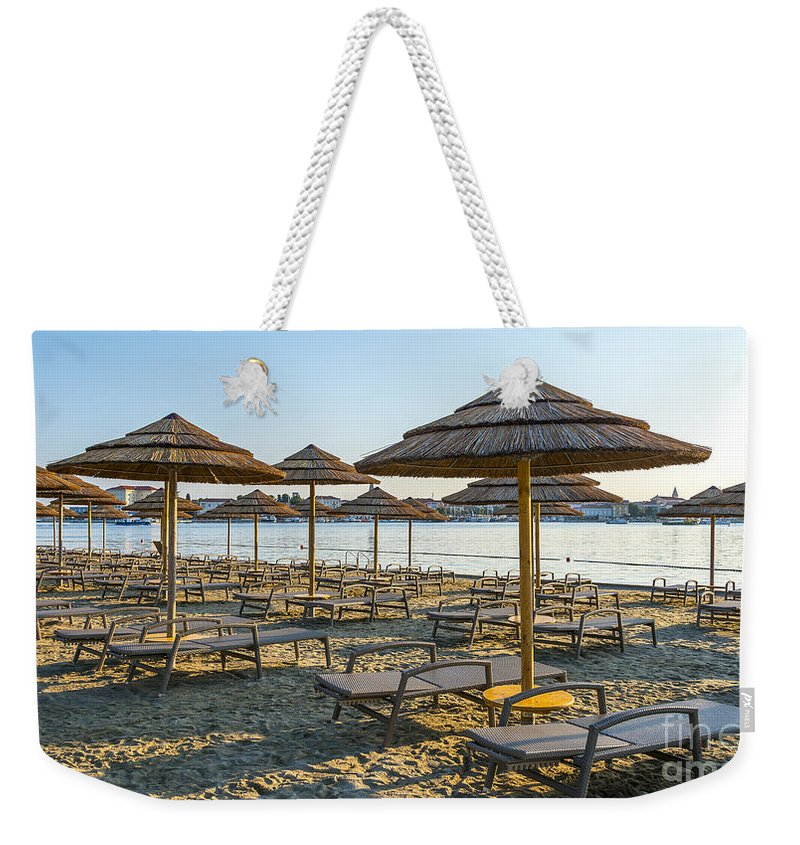 Bay Weekender Tote Bag featuring the photograph Morning Beach by Svetlana Sewell