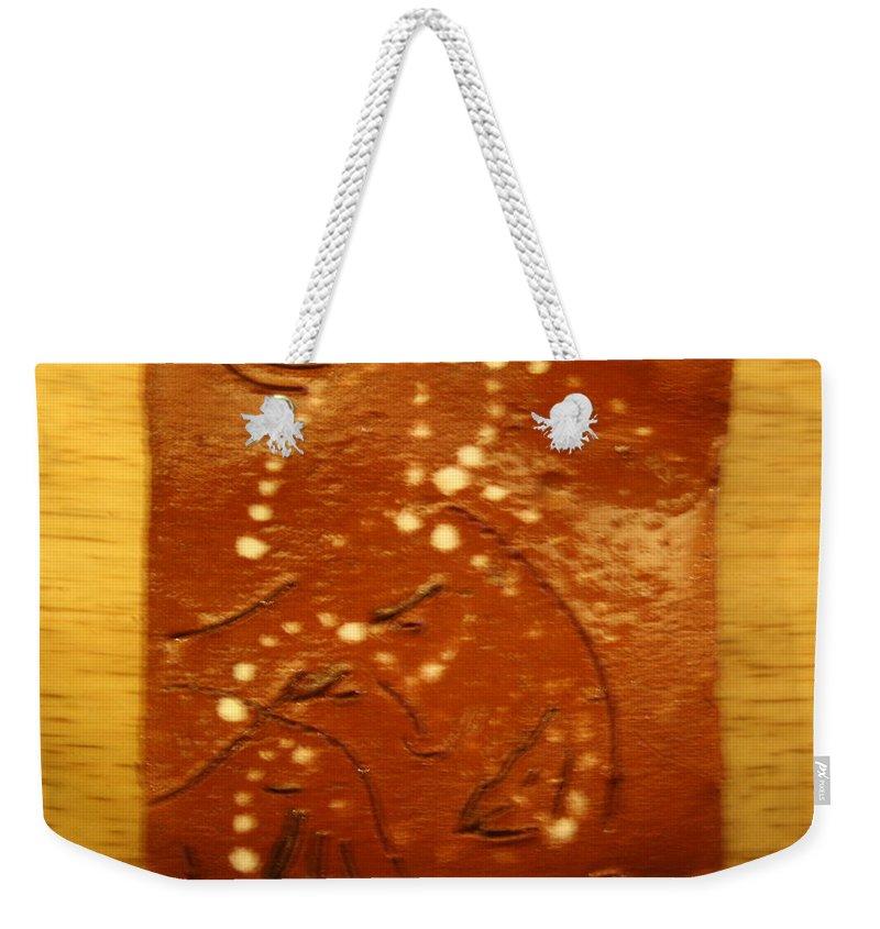 Jesus Weekender Tote Bag featuring the ceramic art Mothers Eyes - Tile by Gloria Ssali
