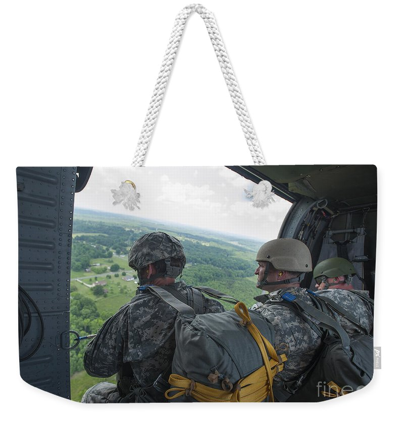 North Carolina National Guard Weekender Tote Bag featuring the photograph National Guard Special Forces Await by Stocktrek Images