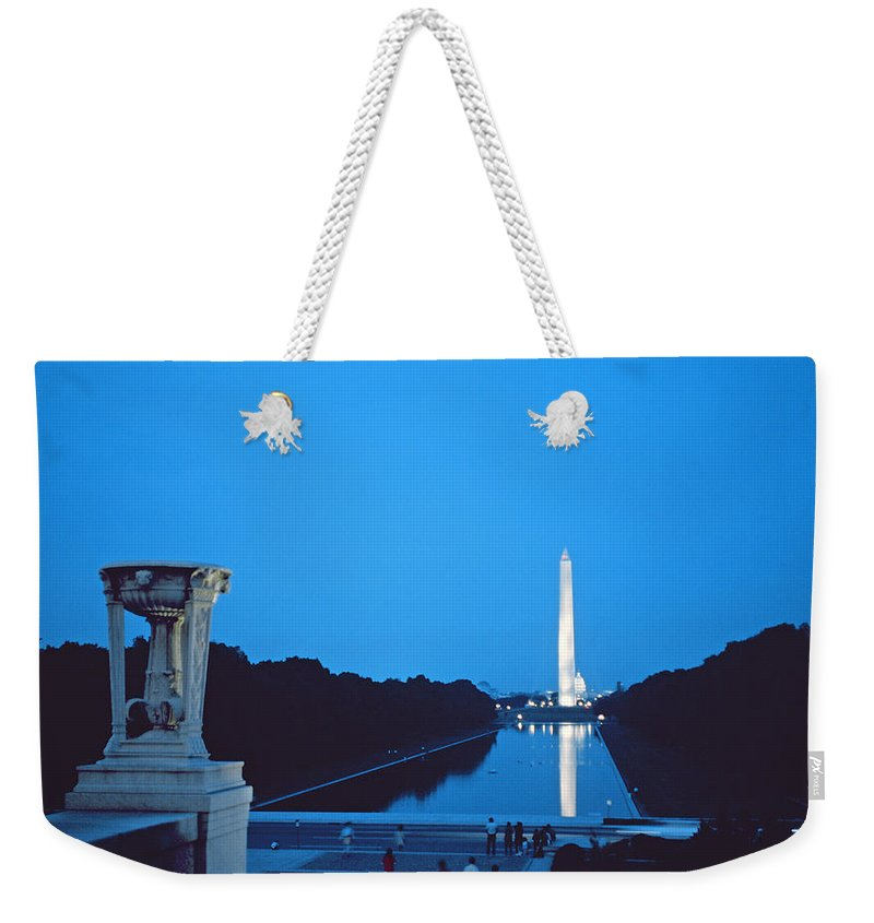 Night View Of The Washington Monument Across The National Mall (photo)washington Weekender Tote Bag featuring the photograph Night View Of The Washington Monument Across The National Mall by American School