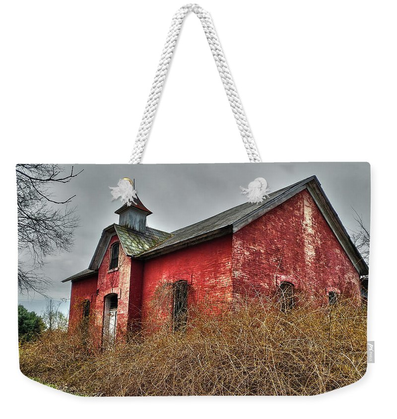 Weekender Tote Bag featuring the photograph Ominous by Melissa Newcomb