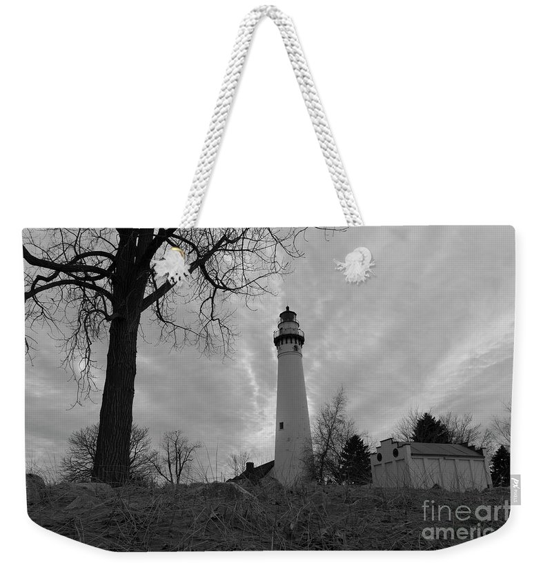 108 Feet Tall Weekender Tote Bag featuring the photograph Overcast Lighthouse by Randall Saltys