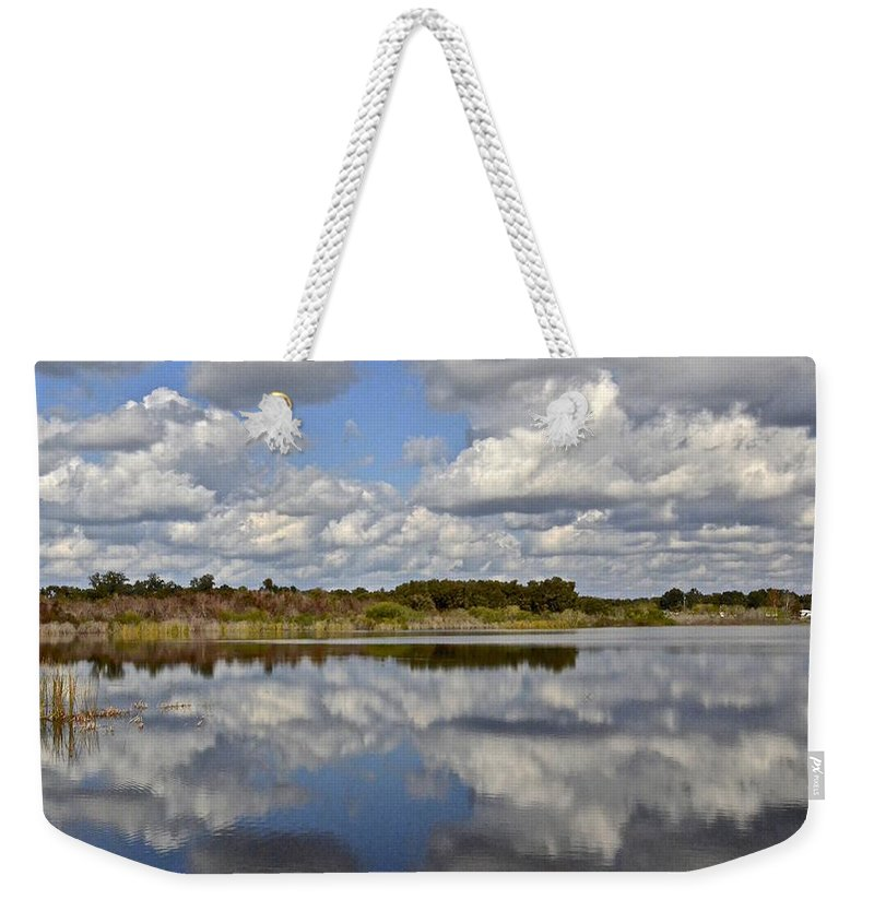 Lake Weekender Tote Bag featuring the photograph Partly Cloudy by Carol Bradley