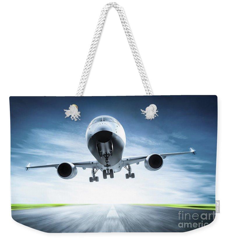 Airplane Weekender Tote Bag featuring the photograph Passenger Airplane Taking Off On Runway by Michal Bednarek