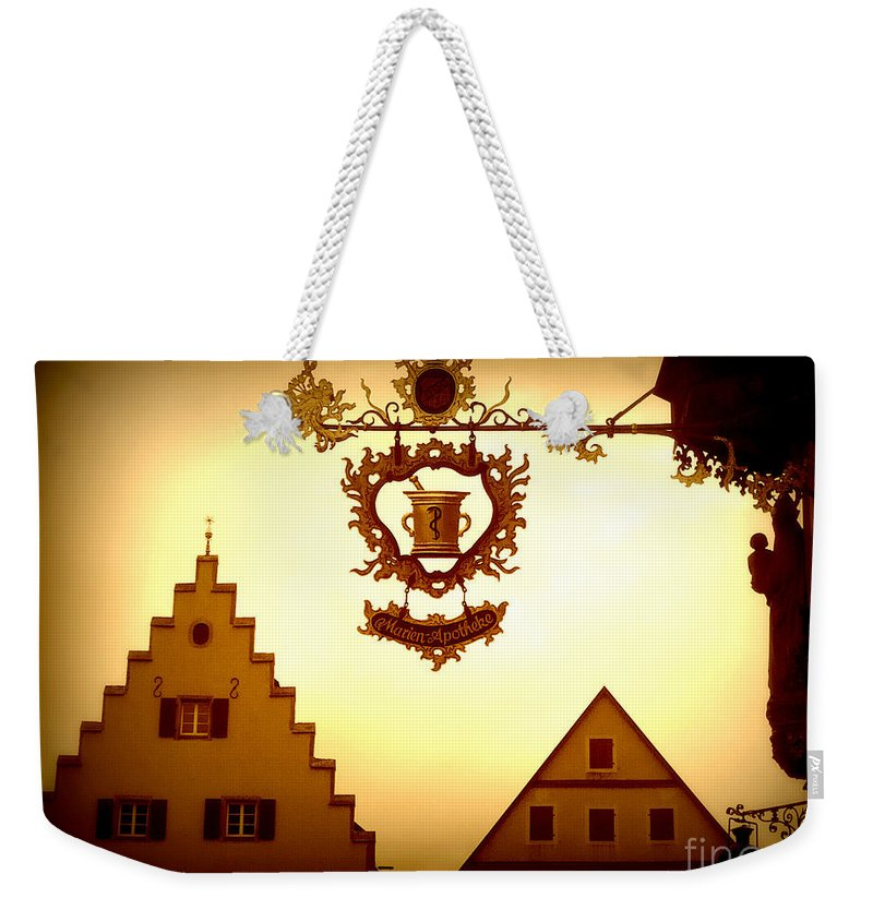 Rothenburg Weekender Tote Bag featuring the photograph Pharmacy Sign In Rothenburg by Carol Groenen