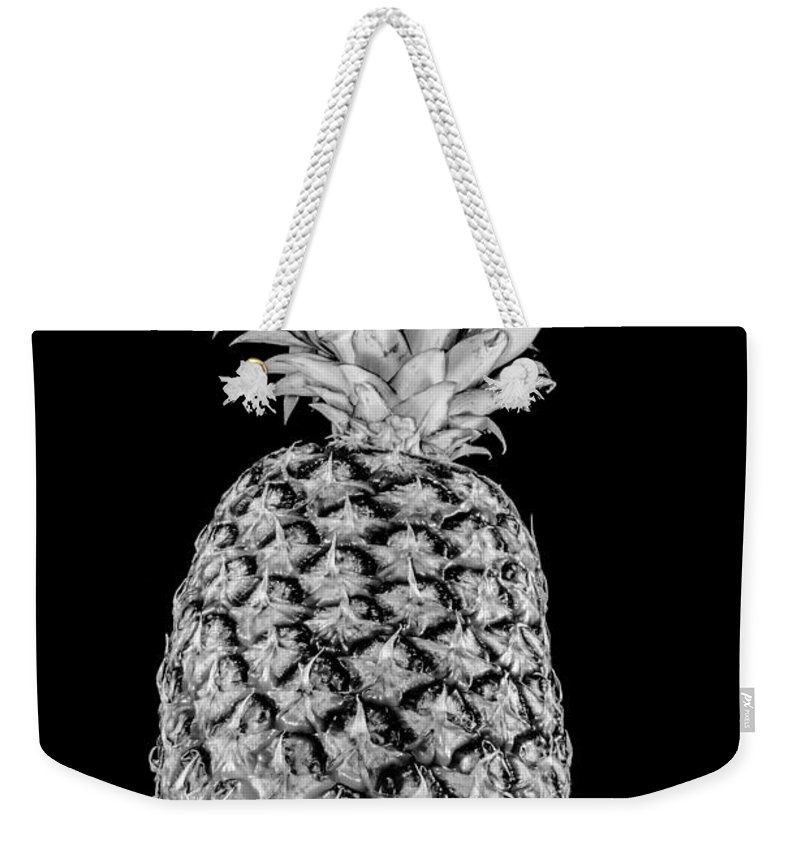 Ananas Weekender Tote Bag featuring the photograph Pineapple Isolated On Black by Alex Grichenko