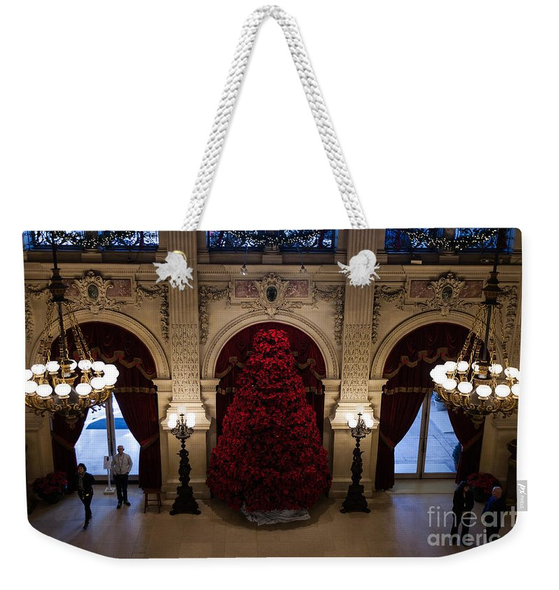 Travel Weekender Tote Bag featuring the photograph Poinsettia Christmas Tree The Breakers by Jason O Watson