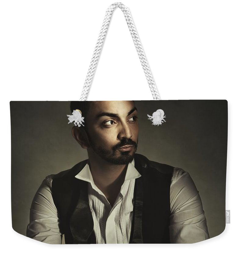 Portrait Weekender Tote Bag featuring the photograph Portrait Of A Young Man by Amanda Elwell