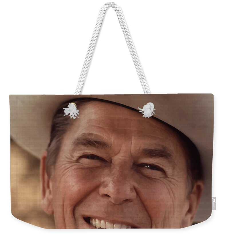 Ronald Reagan Weekender Tote Bag featuring the photograph President Ronald Reagan by War Is Hell Store