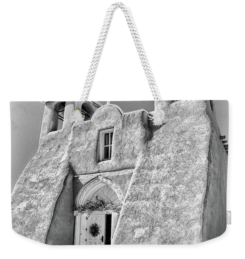 Ranchos Weekender Tote Bag featuring the photograph Ranchos De Taos Church In Black And White by Charles Muhle