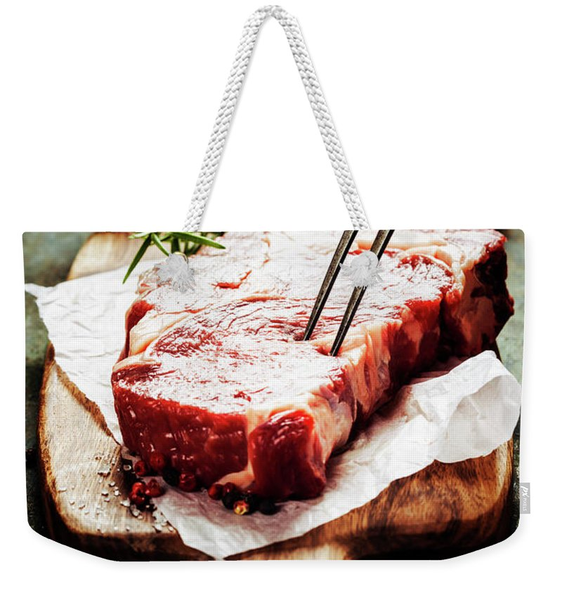 Steak Weekender Tote Bag featuring the photograph Raw Beef Steak And Wine by Natalia Klenova