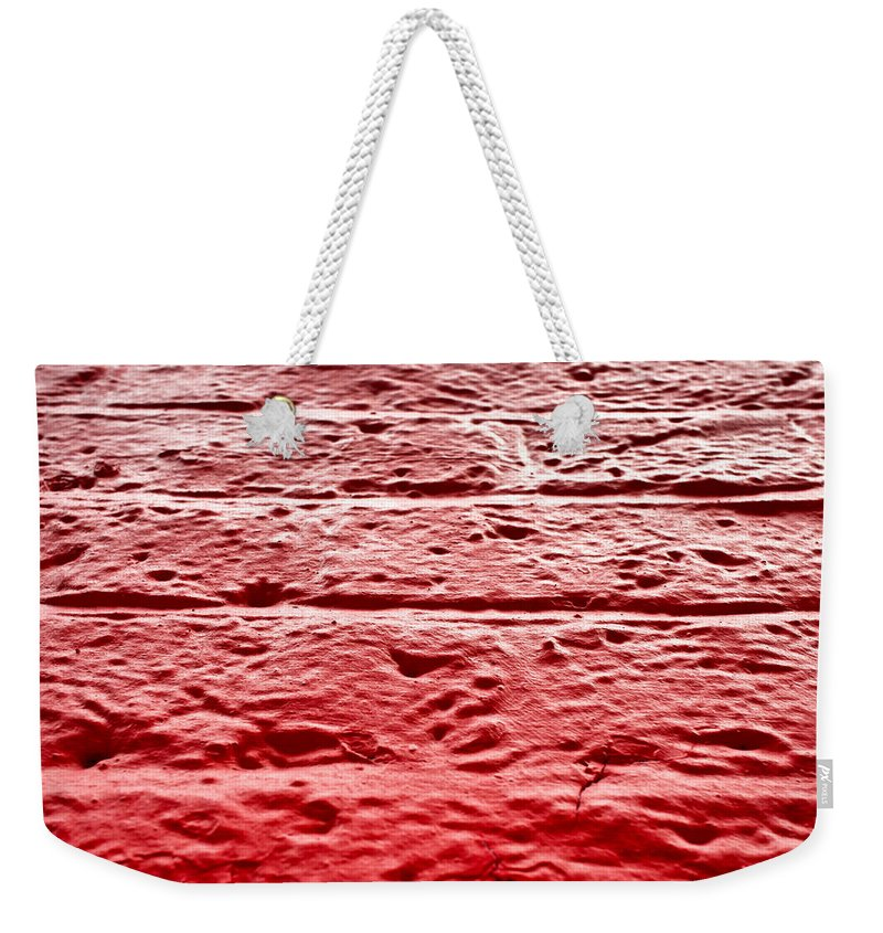 Abstract Weekender Tote Bag featuring the photograph Red Brick Wall by Tom Gowanlock