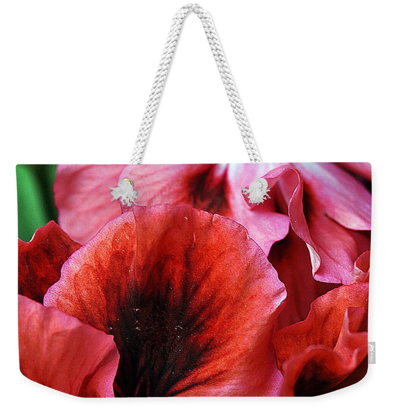 Clay Weekender Tote Bag featuring the photograph Red Floral by Clayton Bruster