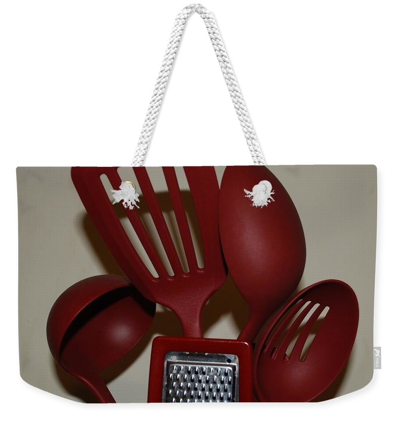 Utencils Weekender Tote Bag featuring the photograph Red Kitchen Utencils by Rob Hans