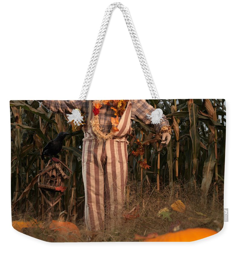 Scarecrow Weekender Tote Bag featuring the photograph Scarecrow In A Corn Field by Oleksiy Maksymenko