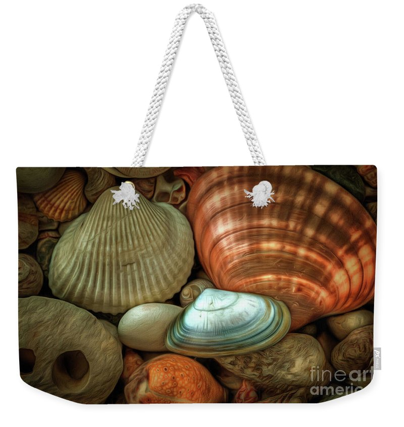 Chiaroscuro Weekender Tote Bag featuring the photograph Sea Pebbles With Shells by Michal Boubin