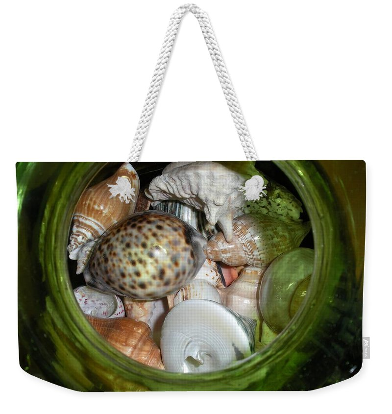 Sealife Weekender Tote Bag featuring the photograph Shells Under Glass by Maria Bonnier-Perez