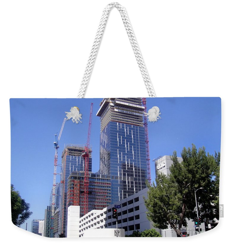 Skyscraper Weekender Tote Bag featuring the photograph skyscraper construction in Downtown Los Angeles... by Sofia Metal Queen