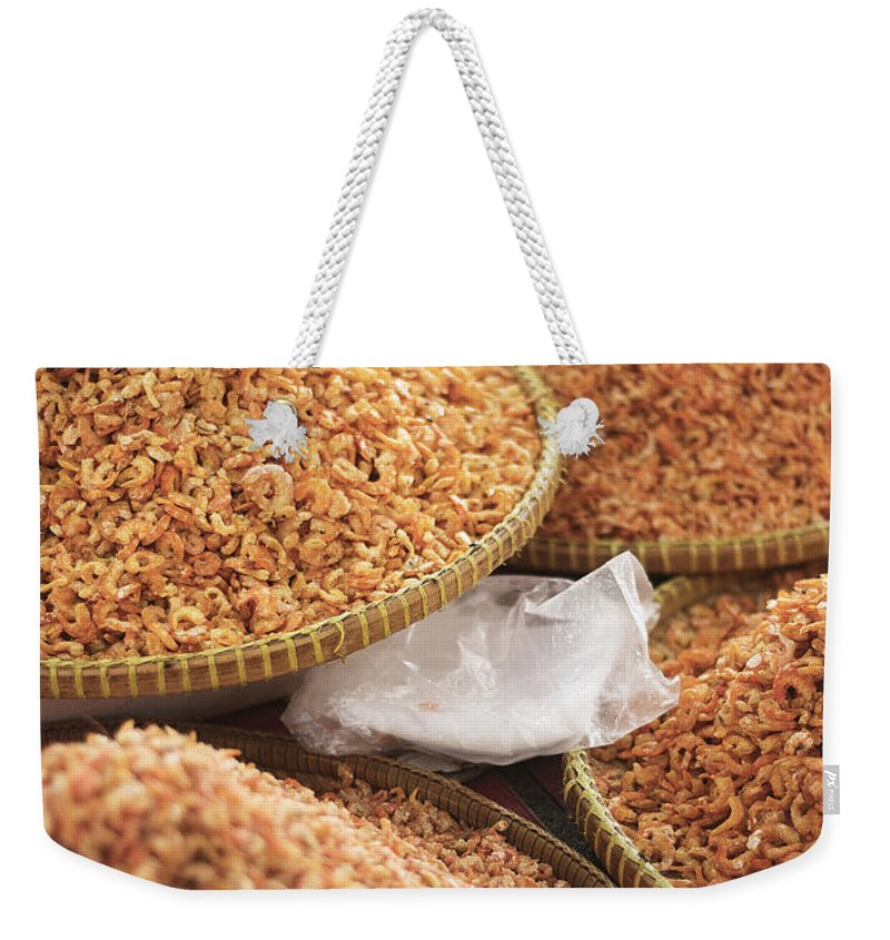 Asia Weekender Tote Bag featuring the photograph Small Asian Dried Shrimp In Kep Market Cambodia by Jacek Malipan