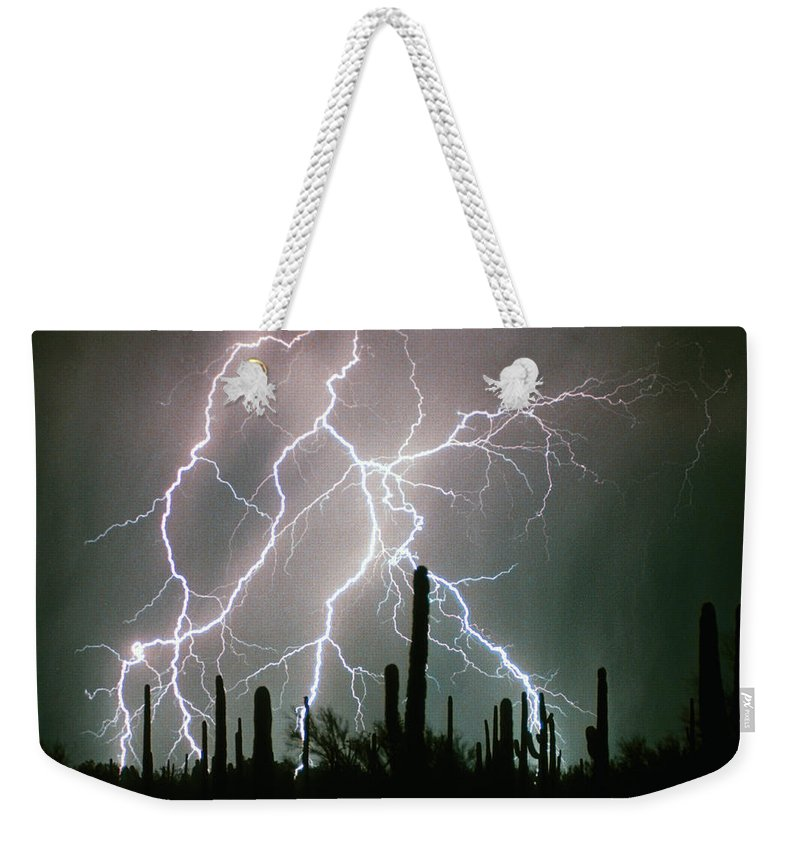 Lightning Weekender Tote Bag featuring the photograph Striking Photography by James BO Insogna