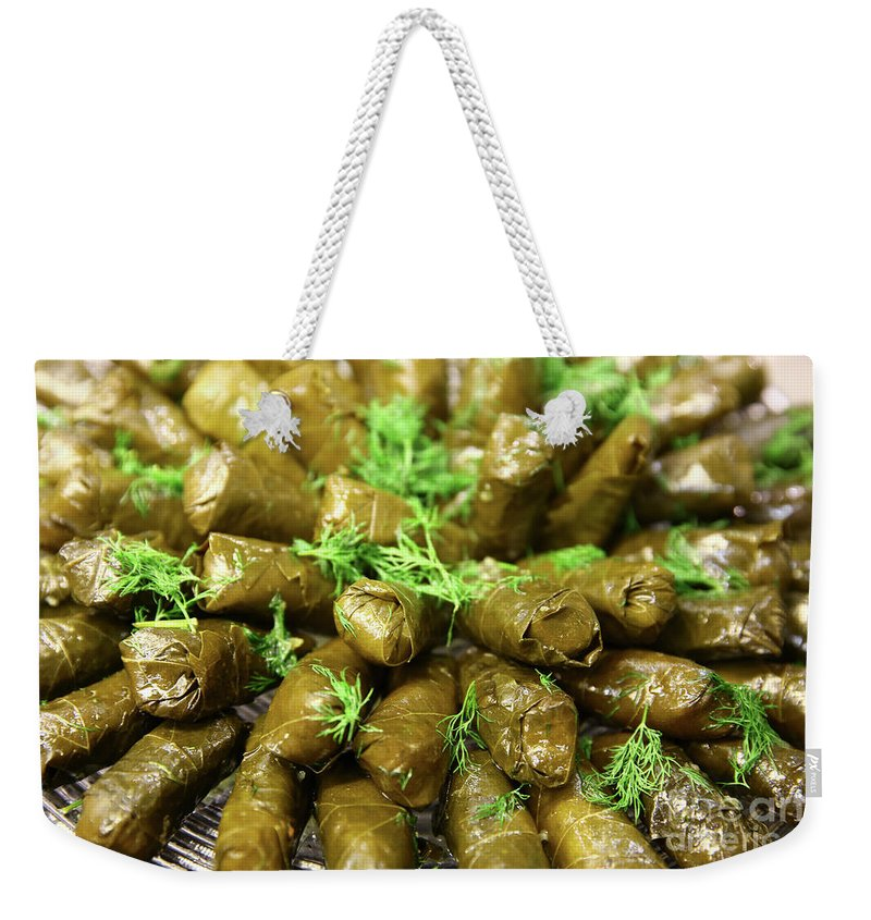 Food Weekender Tote Bag featuring the photograph Stuffed Vine Leafs by Oren Shalev