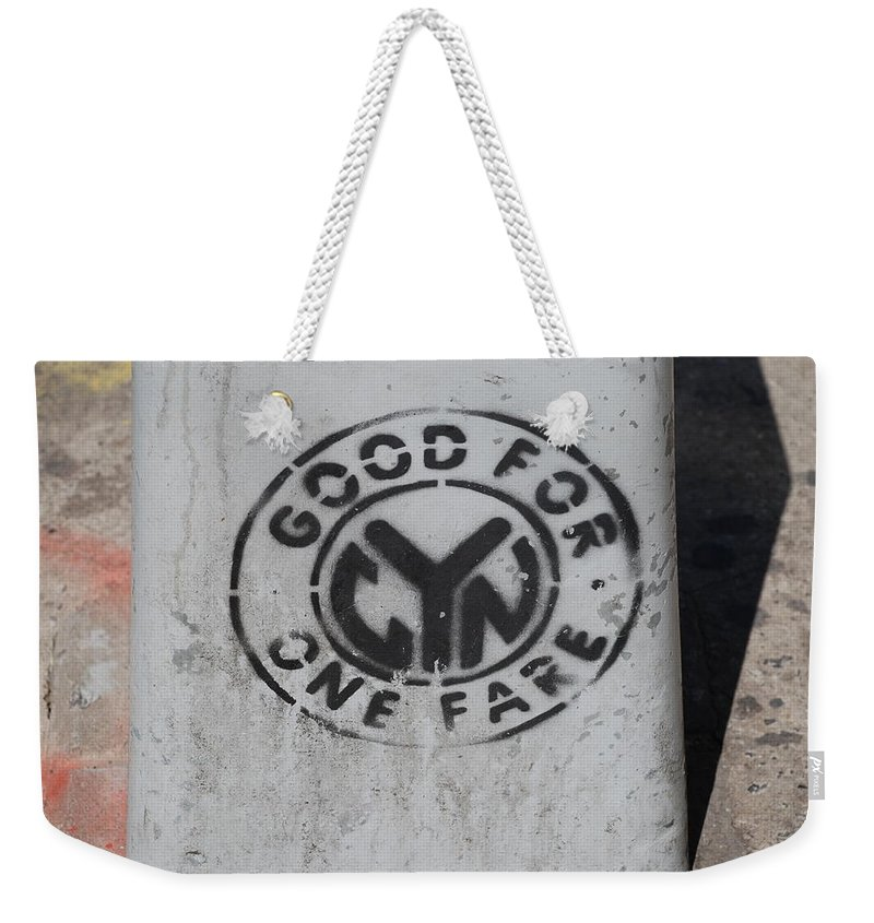 Subway Token Weekender Tote Bag featuring the photograph Subway Token by Rob Hans