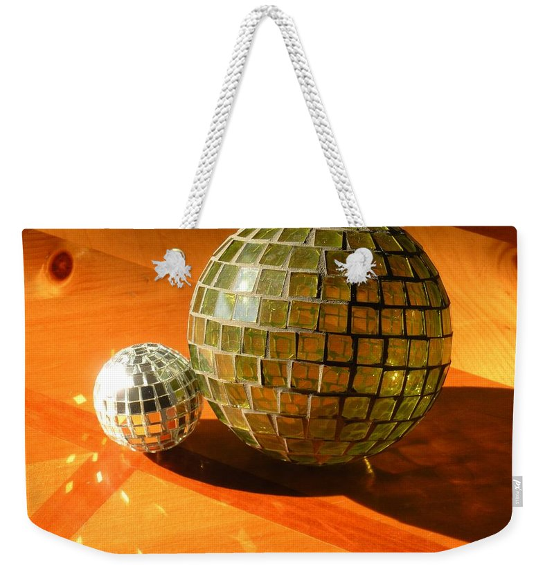 Weekender Tote Bag featuring the photograph Sunlit Spheres by Maria Bonnier-Perez