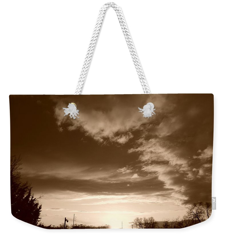 Sunset Weekender Tote Bag featuring the photograph Sunset And Clouds by Rob Hans