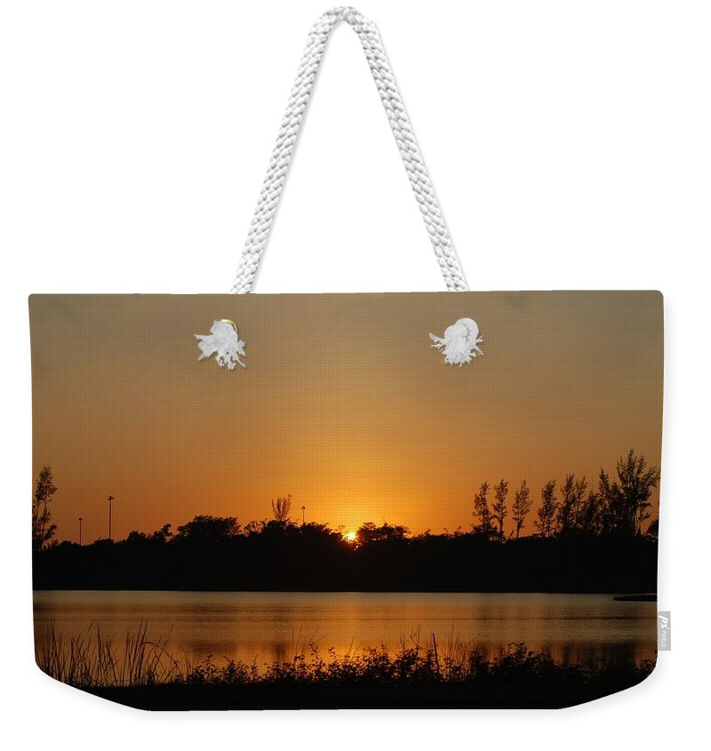 Nature Weekender Tote Bag featuring the photograph Sunset On The Edge by Rob Hans