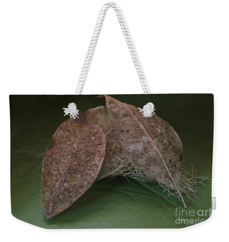 Leaves Weekender Tote Bag featuring the photograph Tangled by Marie Neder