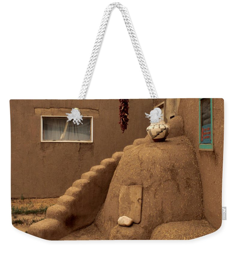 Taos Weekender Tote Bag featuring the photograph Taos Pueblo by Jerry McElroy