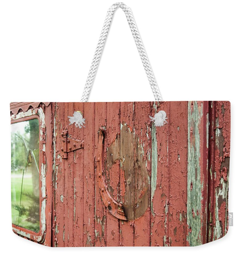 Weekender Tote Bag featuring the photograph Tattered by Melissa Newcomb