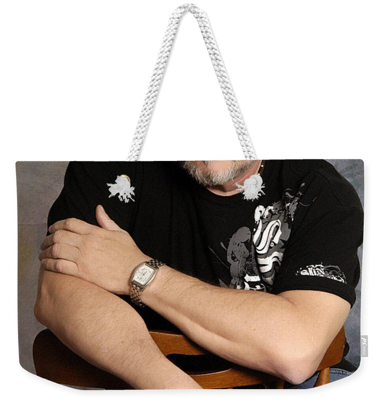 Clay Weekender Tote Bag featuring the photograph The Artist by Clayton Bruster