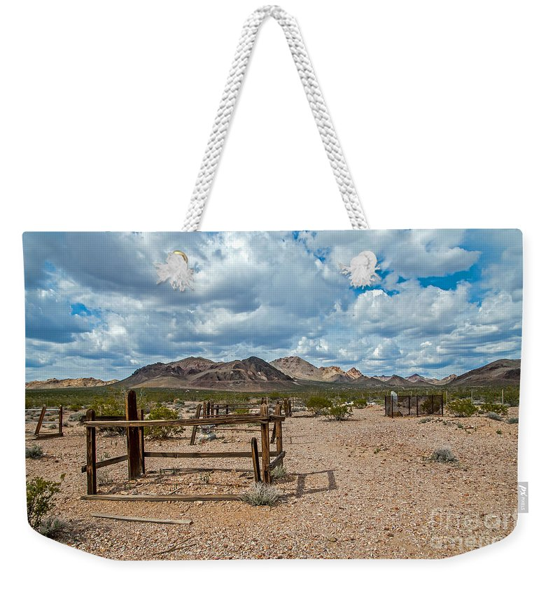 Rhyolite Weekender Tote Bag featuring the photograph The Forgotten by Stephen Whalen