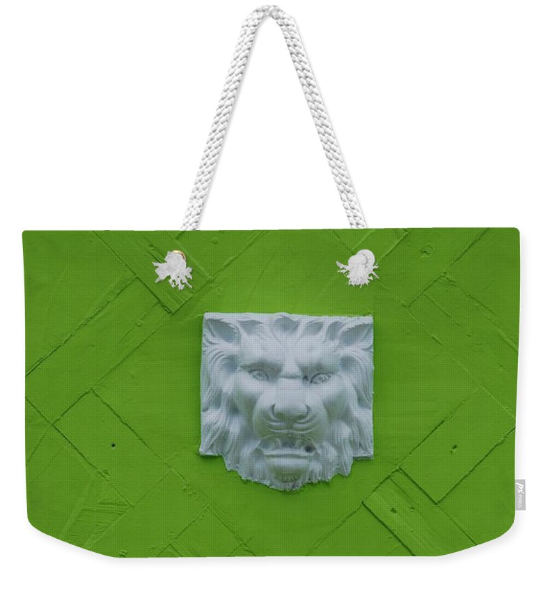 Lion Weekender Tote Bag featuring the photograph The Lion by Rob Hans