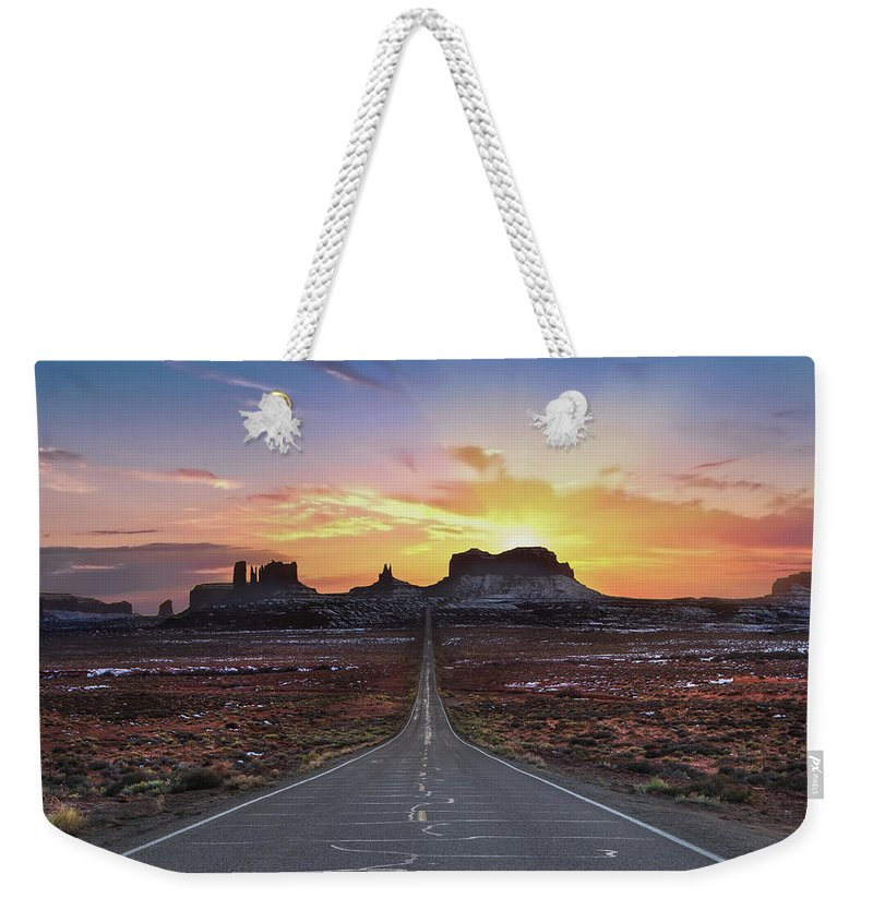Utah Weekender Tote Bag featuring the photograph The Long Road to Monument Valley by Larry Marshall