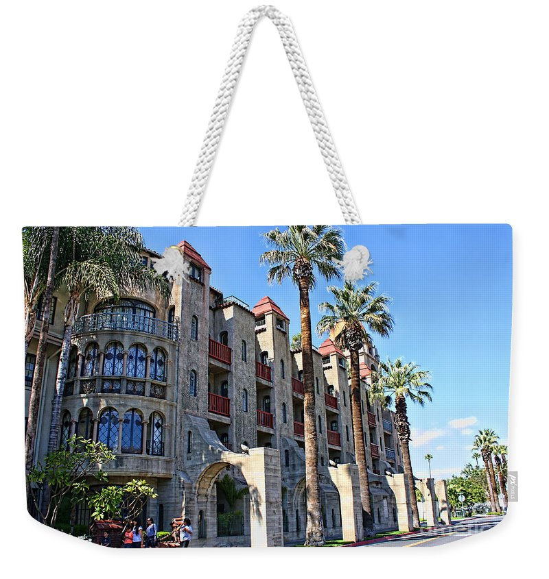 Mission Inn Weekender Tote Bag featuring the photograph The Mission Inn by Tommy Anderson