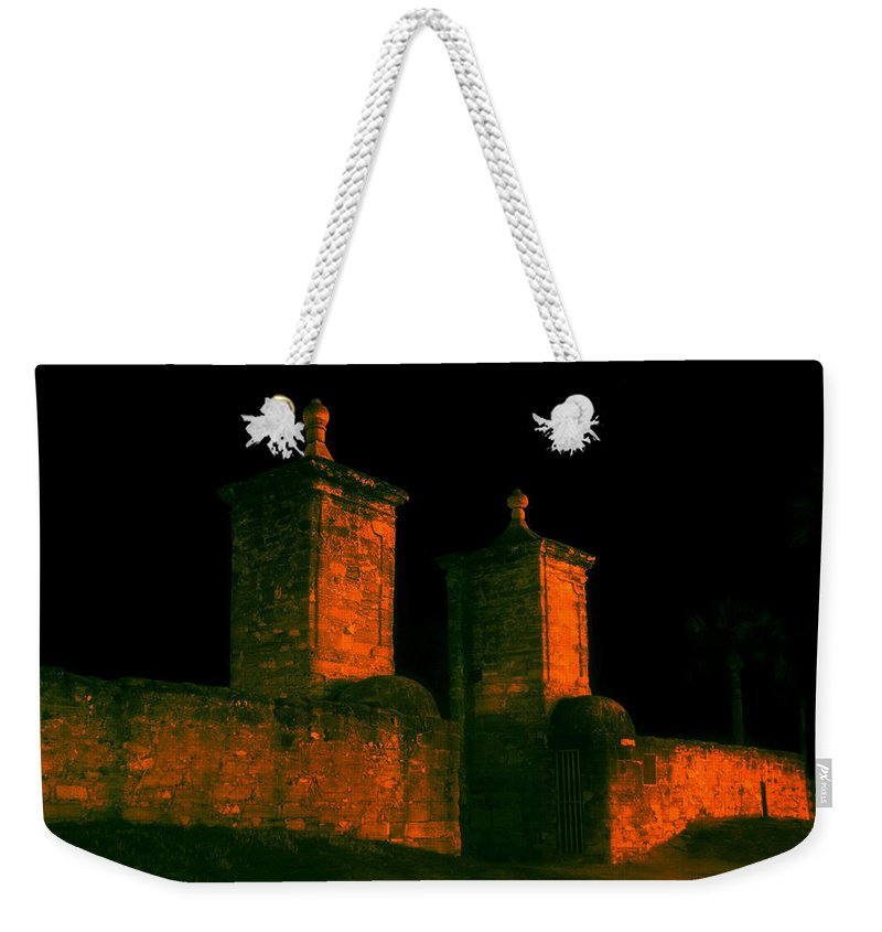 St. Augustine Florida Weekender Tote Bag featuring the photograph The Old City Gates by David Lee Thompson